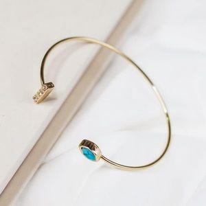 Gold covered cuff bracelet with stone detailing